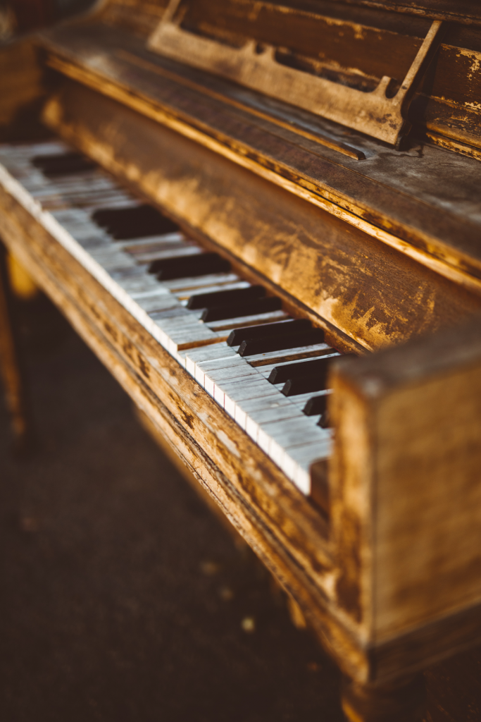 Gold colored wood rustic piano